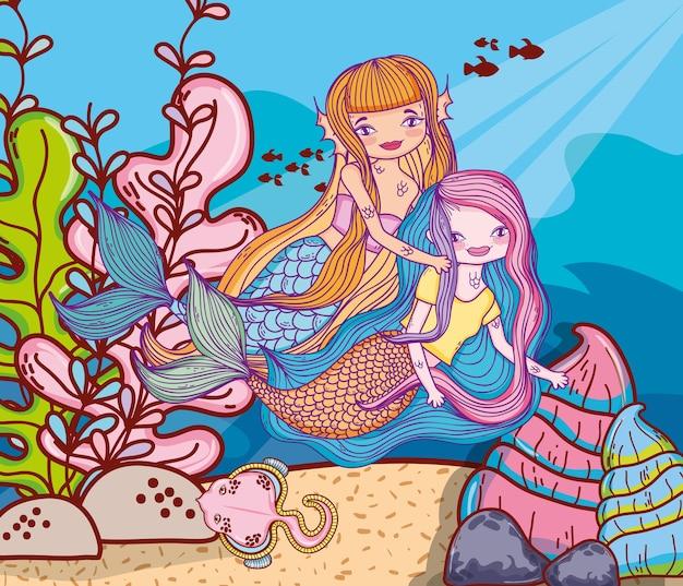 Mermaids swimming undersea