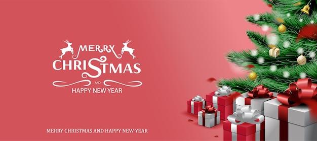 メリークリスマスと新年あけましておめでとうございます、クリスマスツリーの枝と飾りの背景