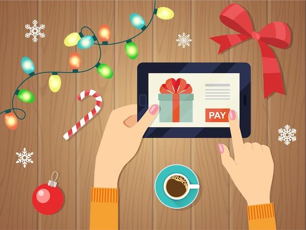 メリークリスマス、そしてハッピーニューイヤー。ガジェット画面のギフト。タブレットを手に持ち、サインインボタンを指でタッチします。ベクトルイラスト。