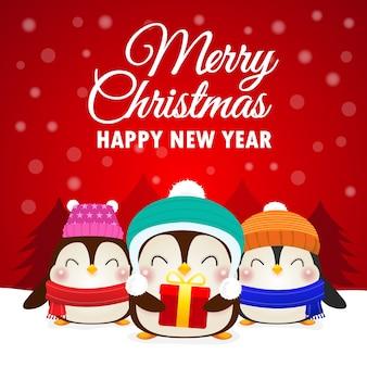 幸せなペンギンのメリークリスマスと新年あけましておめでとうございますの挨拶
