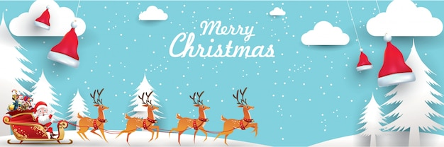 メリークリスマスと新年あけましておめでとうございます。サンタクロースは袋でトナカイのそりを乗っています Premiumベクター