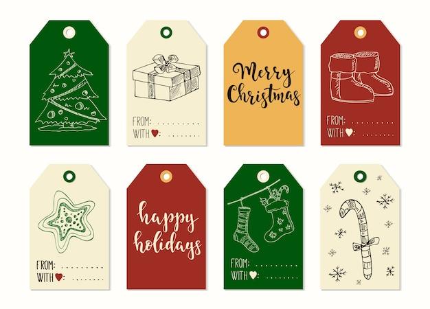 기쁜 성 탄과 새 해 복 많이 받으세요 빈티지 선물 태그 및 서 예 카드. 손으로 쓴 글자. 손으로 그린 디자인 요소. 인쇄 가능한 항목