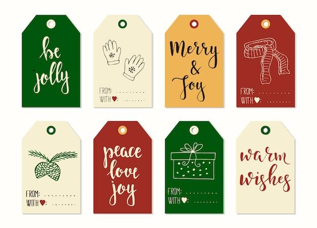 メリークリスマスと新年あけましておめでとうございますビンテージギフトタグと書道とカード。手書きのレタリング。手描きのデザイン要素。印刷可能なアイテム