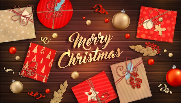 Merry christmas background. red and gold baubles, gift boxes and serpentine