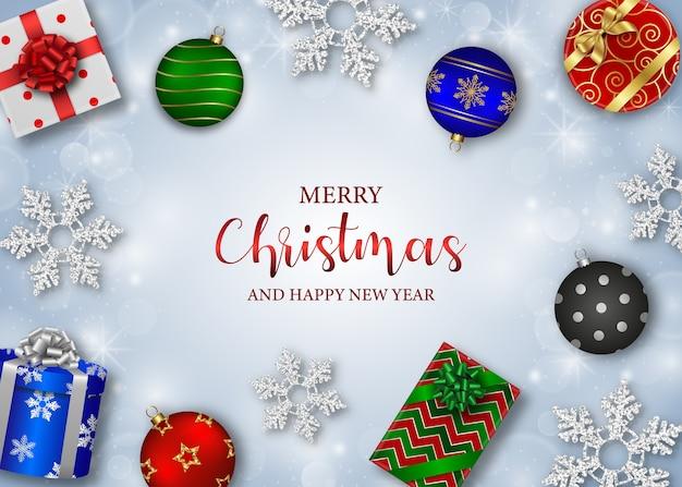 Веселый новогодний фон с подарочными коробками, елочными шарами и снежинками
