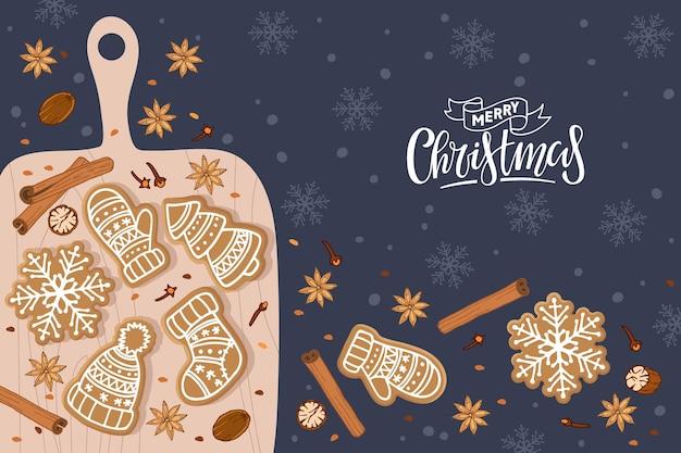 도마에 진저브레드 쿠키와 함께 메리 크리스마스 베이킹과 향신료