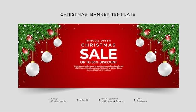 메리 크리스마스 배너 디자인 녹색 잎과 크리스마스 공 빨간색 배경