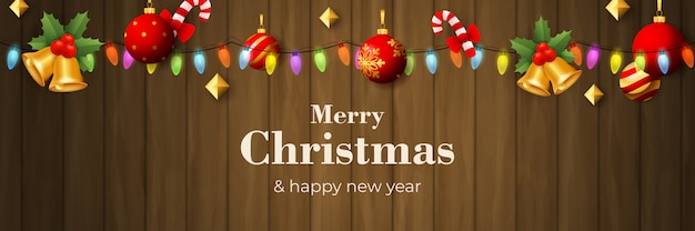 Merry christmas banner with garland on brown wooden ground