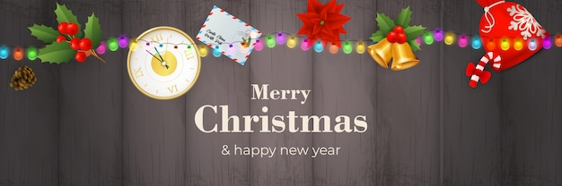 Merry christmas banner with garland on grey wooden ground