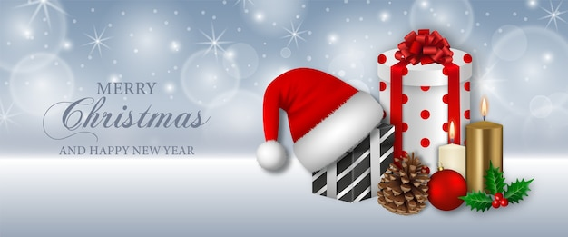 Merry christmas banner with gift boxes, candles and santa claus hat