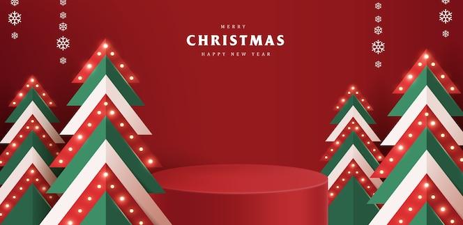 製品ディスプレイ円筒形とクリスマスツリーの照明とメリークリスマスバナー
