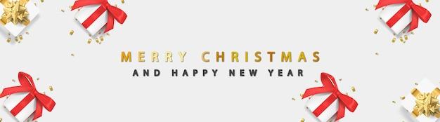 빛나는 황금 텍스트와 흰색 바탕에 giftbox 메리 크리스마스 배너