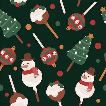 雪だるまの木と装飾品のシームレスなパターンのメリークリスマスケーキポップ