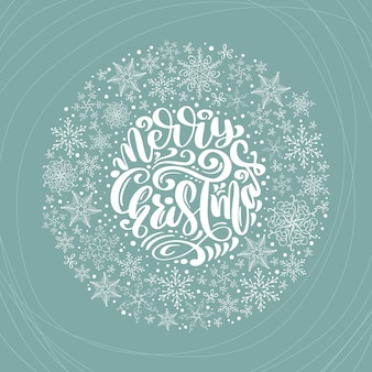 Merry christmas calligraphic lettering hand written text and snowflakes wreath