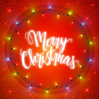 Merry christmas card, illuminated circle of shiny garland lights and lettering