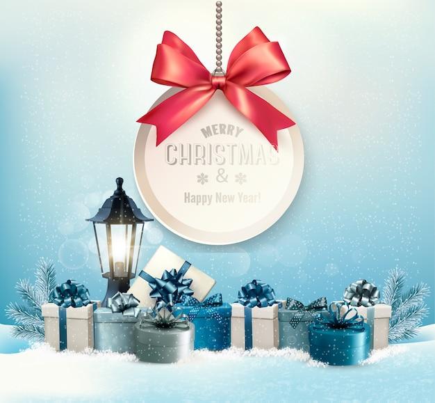 リボンとギフトボックス付きのメリークリスマスカード