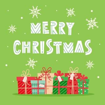 Веселая рождественская открытка с надписями и подарками.