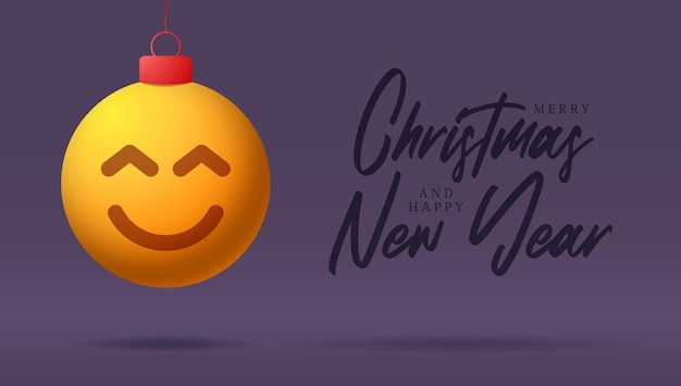 Merry christmas card with smile emoji face. vector illustration in flat style with xmas lettering and emotion in christmas ball hang on thread on background