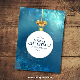 Merry christmas card with snowflakes and bokeh effect