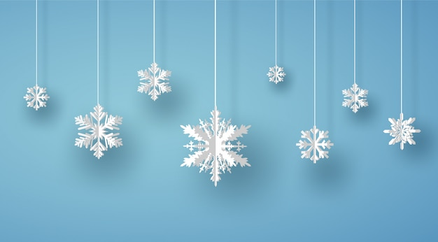 Merry christmas card with white origami snowflake or ice crystal on blue background
