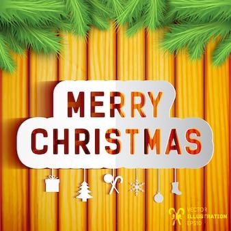 モミの木の枝で飾られた木製の壁に冬のシンボルとメリークリスマスカード