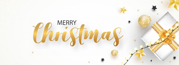 Merry christmas celebration header or banner  with top view of gift box, baubles, stars and lighting garland decorated on white .