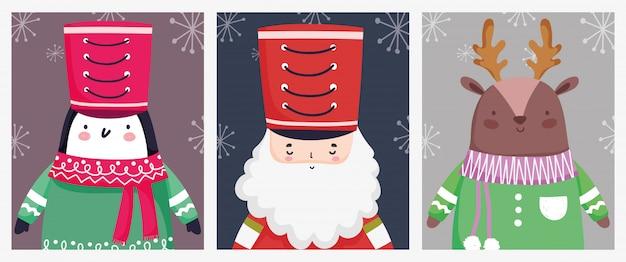 メリークリスマスのお祝いくるみ割り人形兵士ペンギンと鹿
