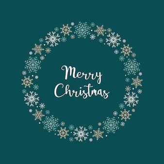 メリークリスマス。さまざまな雪片の丸いフレームと、緑の背景に刻まれたクリスマスカード。