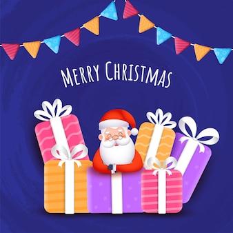 귀여운 산타 클로스와 다채로운 선물 상자와 파란색 브러시 질감 배경에 깃발 천 플래그와 함께 메리 크리스마스 개념.