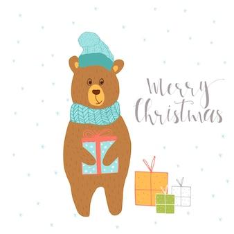 クマとプレゼントのギフトが付いているメリークリスマスかわいいグリーティングカード。ポスター、招待状、子供部屋、保育園の装飾、インテリアデザインの手描きのレタリング。
