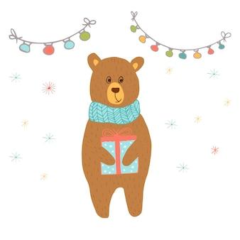 クマとプレゼントのギフトが付いているメリークリスマスかわいいグリーティングカード。招待状、子供部屋、保育園の装飾、インテリアデザインのポスターの手描きスタイル。