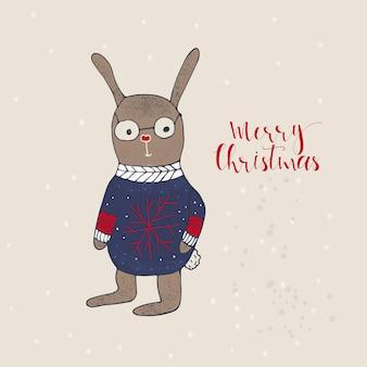 プレゼント用うさぎのメリークリスマスかわいいグリーティングカード。手書きのスタイル、休日の招待状、子供部屋、保育園の装飾、インテリアデザイン、パーティーの招待状、本の表紙