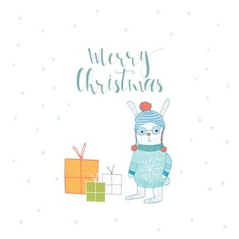 レタリング、うさぎ、プレゼント付きのメリークリスマスかわいいグリーティングカード。招待状、子供部屋、保育園の装飾、インテリアデザインのポスターの手描きスタイル。