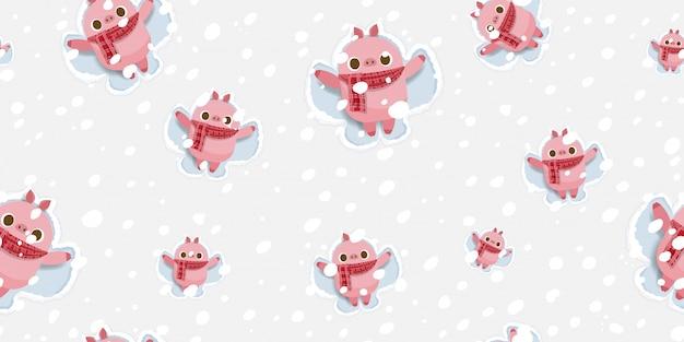 メリークリスマス、雪の天使のパターンを作るかわいい豚。