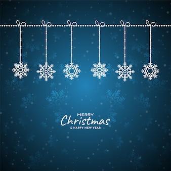 メリークリスマスフェスティバル雪片青い背景