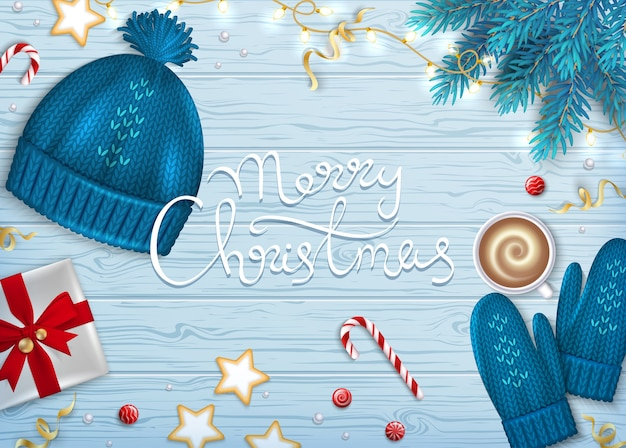 Счастливого рождества приветствие фон зимние элементы вязаная шапка, варежки, кофе, подарочная коробка с бантом