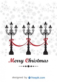 Merry christmas greeting card with decorative lamppost and snowing background