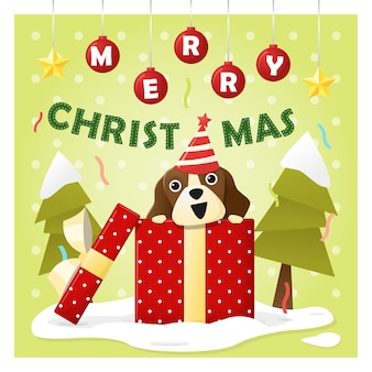 Merry christmas greeting card with dog inside gift box