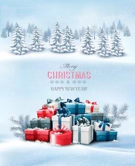 선물 상자와 풍경 메리 크리스마스 인사말 카드.