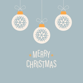 Merry christmas greeting card with hanging white christmas balls and text on a blue background