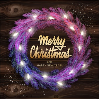 Merry christmas greeting card with a realistic colorful wreath of pine tree branches, decorated with christmas lights. modern lettering merry christmas in gold