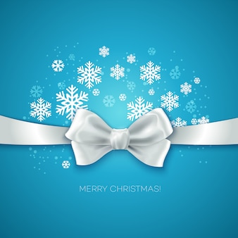 Merry christmas greeting card with ribbon with white silk bow