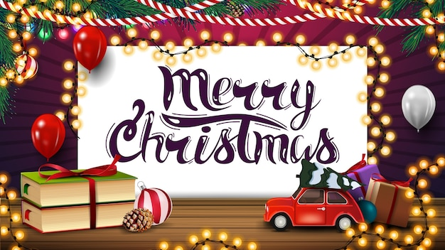 С рождеством, поздравительная открытка с листом бумаги, гирляндами, воздушными шарами, книгами и красной винтажной машиной с елкой