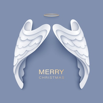 Merry christmas greeting with white angel wings and golden nimbus