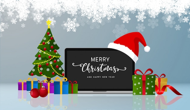 Merry christmas greetings and happy new year realistic laptop monitor with santa hat. vector.