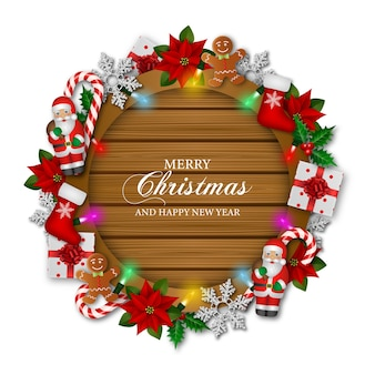Merry christmas greetings with decorations  and lights on wooden board