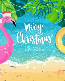 Merry christmas hand lettering for exotic new year celebration. pink flamingo, tropical leaves.