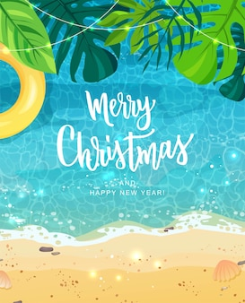 Merry christmas hand lettering for exotic new year celebration. summer seashore, tropical leaves.