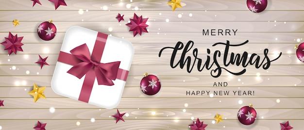 メリークリスマス手レタリングテキストカード。お祭りの要素を持つ新年とクリスマスの休日デザインのタイポグラフィ碑文。 Premiumベクター
