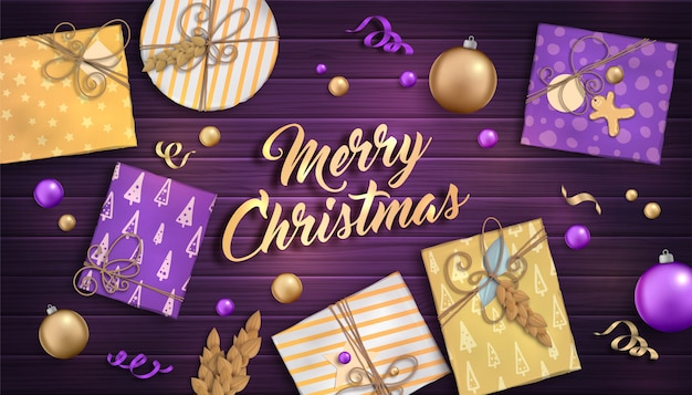 Merry christmas and happy new year. background with christmas decoration - purple and gold baubles, craft gift boxes and garlands on wooden backdrop
